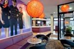 Отель MEININGER Hotel Frankfurt Main / Airport