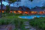 Отель Tladi Lodge