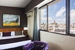 Отель Catalonia Giralda Hotel