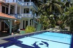Отель The Oasis Villa