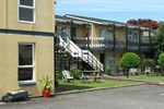 Отель Asure Saddle and Sulky Motor Lodge