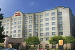Отель The Plaza Suites
