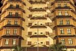 Отель Travellers Suites