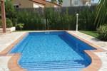 Апартаменты Holiday home Urb. Perelló Mar II N.