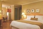 Апартаменты Sunset Inn and Suites