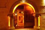 Отель Avanos Suites