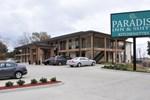 Отель Paradise Inn & Suites