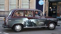 такси-кэб с рекламой / Великобритания