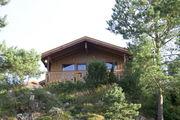 Типичный домик в кемпинге около Рисера / Норвегия