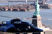 Вертолет US Helicopter у статуи Свободы в Нью-Йорке // delta.com
