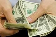 Один американский доллар можно поменять на 11,3 боливара. // iStockphoto