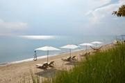 Пляж отеля Ikos Olivia // ikosresorts.com